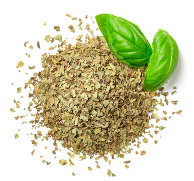 dried crushed basil leaves and fresh basil isolated on white, top view