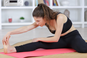 cute attractive woman during yoga exercise at home