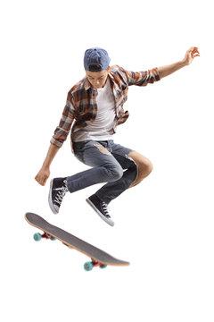 Teenage skater boy jumping