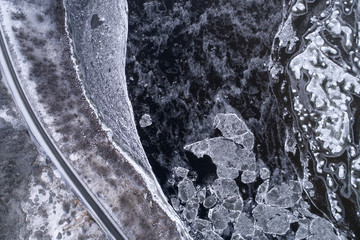 Aerial view of ice formations on frozen river