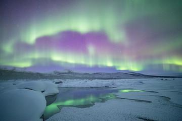 Aurora borealis reflection on the river