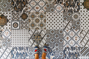 Upper view of summer shoes and decorative retro porcelain tile