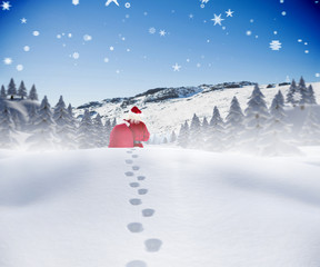 Santa walking in the snow against snowy mountain under blue sky