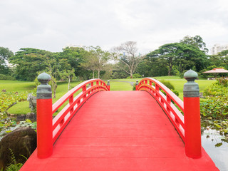 Red Bridge in Japanese Garden Singapore.  The bridge Symbolized The Path to Paradise and Immortality