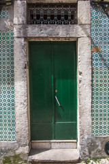 doors of a historic house in the old town of Lisbon, Portugal