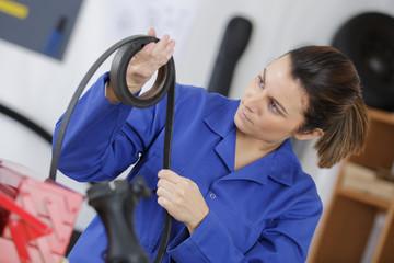 worker inspecting a rubber belt