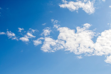 Blue sky background with white light clouds.