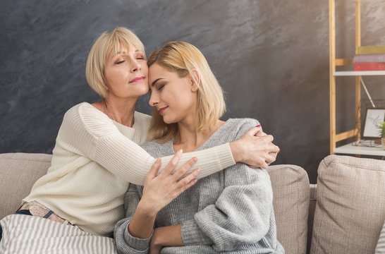 Adult mother and daughter together at home