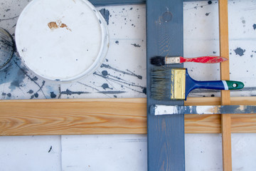 Art background. Brushes for painting on wooden canvas