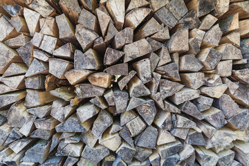 Closeup of perfect pile of chopped wood stored for winter