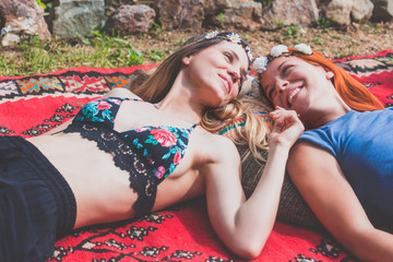 Two hippie girlfriends enjoying in the countryside