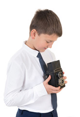 The young photographer the teenager with the camera in hands on the white isolated white background.