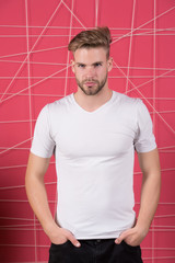 Man or guy in blank white tshirt stand on pink background