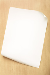 White paper with fold inside corner on wood background, Blank paper