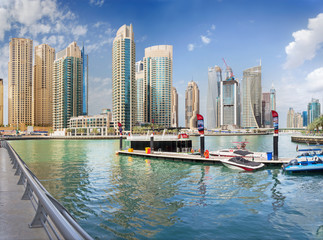 DUBAI, UAE - MARCH 24, 2017: The skyscrapers of Marina and the yachts.