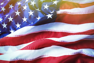 American flag background. Brightly lit American flag. Sunlight, sunflare.