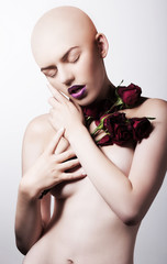Studio shot of naked hairless woman with roses