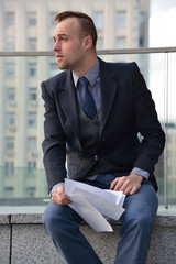 tired businessman reading  paper documents