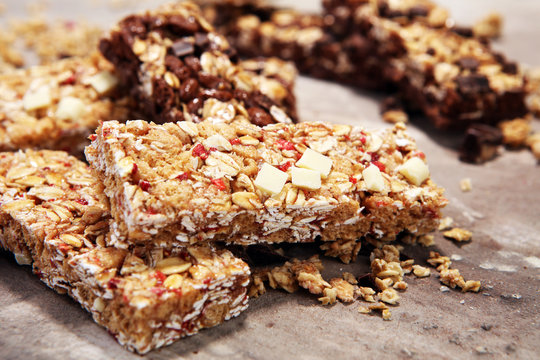 Granola bar. Healthy sweet dessert snack. Cereal granola bar with nuts, fruit and berries