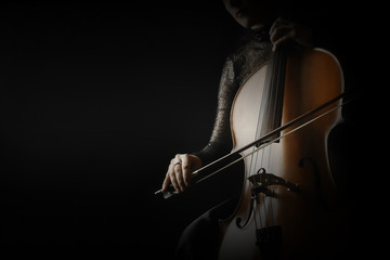 Photo sur Plexiglas Musique Cello player. Cellist hands playing cello closeup