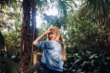 Girl tourist walking in the tropical forest