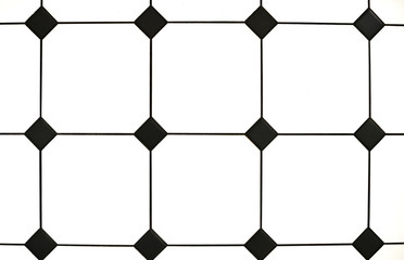 Elements of interior. Stylish black and white tiles. Close-up
