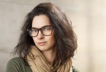 Closeup portrait of attractive woman in glasses