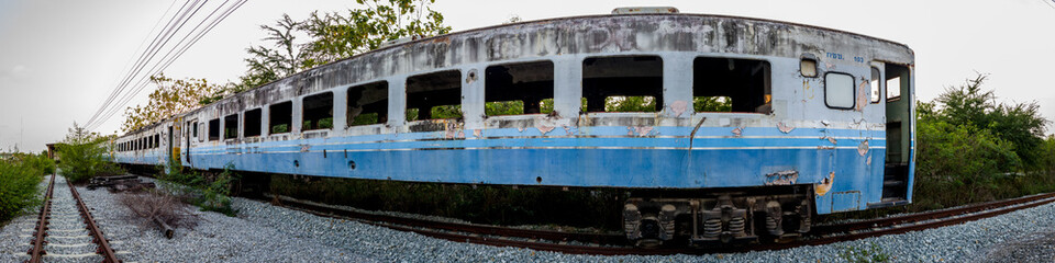 panorama of old bogey of retired train park at the inactive railroad, fish eye style