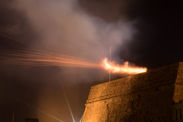 Cannon firing from Upper Barrakka Gardens during the Malta International Fireworks Festival 2017, Valletta, Malta, April 2017