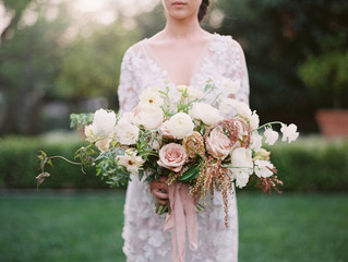 Bride  holding large wedding bouquet
