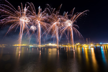 Malta International Fireworks Festival 2017, colourful fireworks over the Grand Harbour, in front of Fort St Angelo, Valletta, Malta, April 2017
