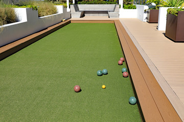 Upscale bocce ball court with artificial turf on a rooftop terrace.