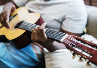 Man playing on his guitar