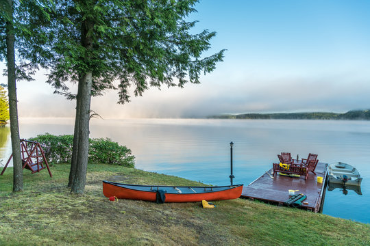 Cottage life - still life, early morning mist lifts from small lake