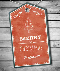 Merry Christmas banner against digitally generated grey wooden planks