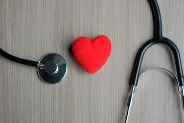 Red heart and  stethoscope. Healthcare and Insurance concept
