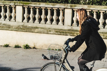 Girl Riding her Bike in Paris, France