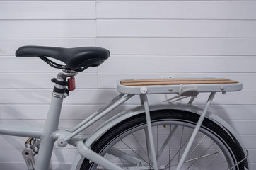 Close up image part of vintage bicycle with leather and wooden seat