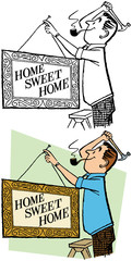 A man hangs a Home Sweet Home sign on a wall in his house.