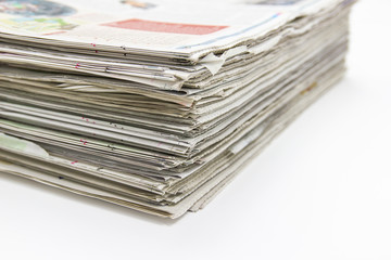 Closeup - Newspaper Stack on white table