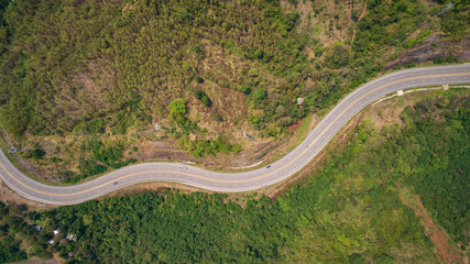 Asphalt road on the hill in Phetchabun province, Thailand. Aerial view from flying drone.