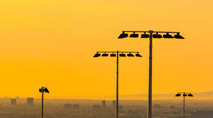 Field lights in Suburban Orange County landscape at sunset in Southern California