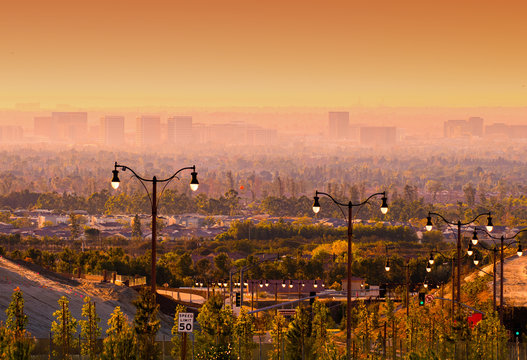 Streetlights in Suburban Orange County landscape at sunset in Southern California