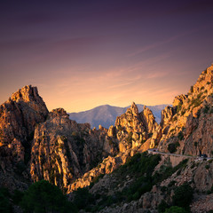 Sunset at the road along the famous Calanques de Piana in Corsica, France