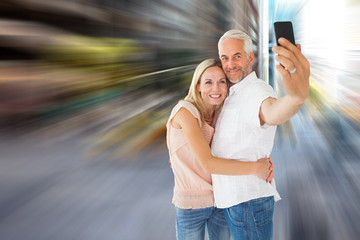 Happy couple posing for a selfie against new york street