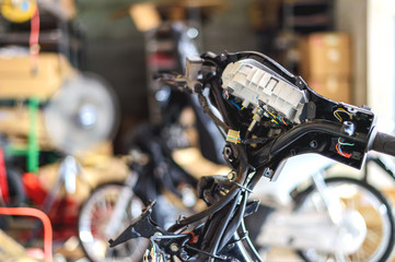motorcycle repair with soft-focus and over light in the background