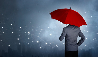 Businessman standing while holding red umbrella over the networking connection and storm in city huge rain background. Business crisis and business leader concept, being different concepts