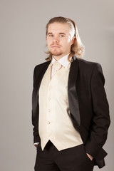 Portrait of handsome young man in a tuxedo. Fashionable clothing for the festive evening
