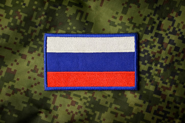 Russian national flag, military chevron on camouflage background