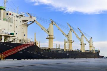 Bulk cargo vessel berthing at port waiting for discharging cargoes.